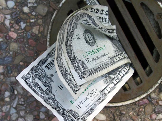 15391507_1607819194qzodollars_down_the_drain.jpg